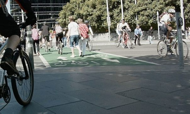 pedestrians wandering into the middle of bicycles using exclusive bicycle lanes